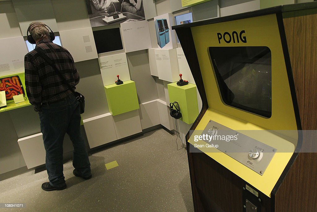 A visitor listens to an audio presentation next to a standing console of Pong, one of the earliest, commercially successful video games, at the Computer Game Museum (Computerspielemuseum) on January 26, 2011 in Berlin, Germany. The museum, which opened January 21, traces the evloution of computer games through approximately 300 exhibits.