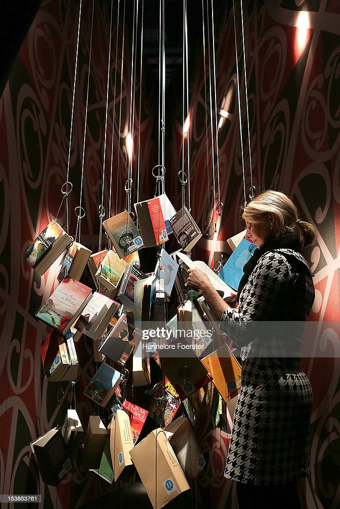 A visitor look at hanging books at the New Zealand stand at the Frankfurt Book Fair on October 10, 2012 in Frankfurt, Germany. The Frankfurt Book Fair is the largest in the world and will run from October 10 - 14, 2012.
