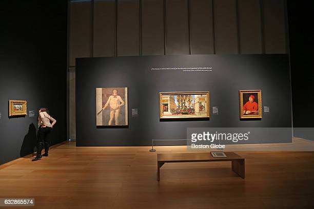 A visitor look at paintings in the Isabella Stewart Gardner Museum's 'Off The Walls' exhibition in which some of the museum's most precious paintings...