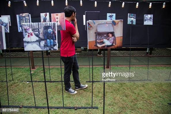 Visitor look photos at quotMencari Amangquot by Ridwan Siregar a photo exhibition about RIDHWAN SIREGAR a freelance photographer from Indonesia held...