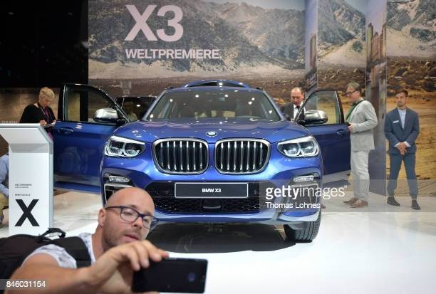 Visitor look to a BMW X3 car at the 2017 Frankfurt Auto Show on September 12 2017 in Frankfurt am Main Germany The Frankfurt Auto Show is taking...