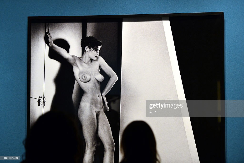 A visitor looka at a photo by German-Australian photographer Helmut Newton during a press preview of the 'White women / Sleepless nights / Big nudes' exhibition at the Palazzo delle Esposizioni on March 5, 2013 in Rome. The exhibition will run from March 6 to July 21, 2013.