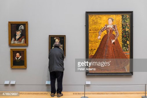Visitor looking at paintings, Tate Britain, London