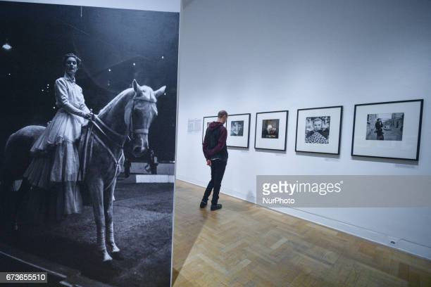 A visitor looking at pictures by US photographer Gordon Parks at the exhibition The Camera Is My Weapon in Zacheta the National Gallery of Art in...