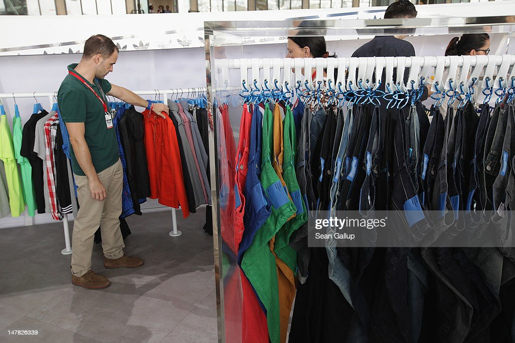 A visitor looks among the Demin Collection at the adidas Originals Spring/Summer 13 collection at the Bread and Butter 2012 fashion trade fair on July 4, 2012 in Berlin, Germany.