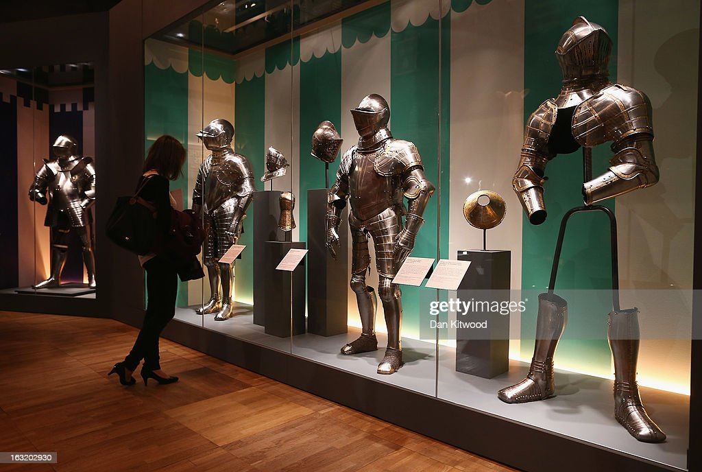 A visitor looks at 16th century suits of armour during a press preview of the V&A's new exhibit on March 6, 2013 in London, England. The exhibition, 'Treasures of the Royal Court: Tudors, Stuarts and the Russian Tsars' examines the development of cultural diplomacy and trade between Britain and Russia from it's origins in 1555. The runs at the V&A museum until July 14, 2013.