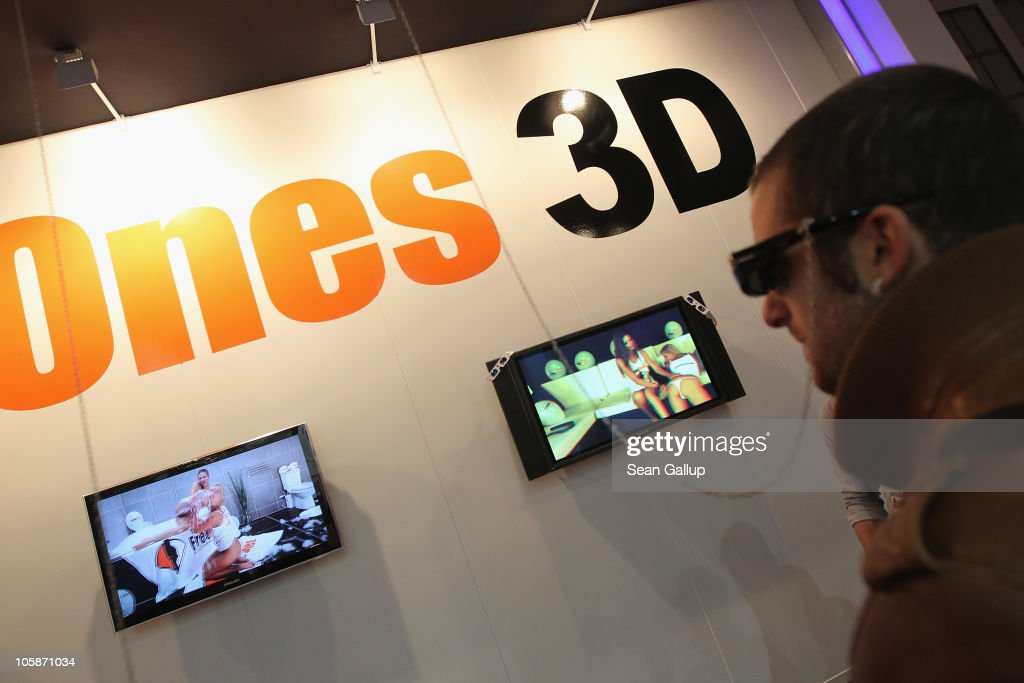 A visitor looks at a 3D video porn presentation on the industry professionals' day at the 2010 Venus Erotic Fair at Messe Berlin on October 21, 2010 in Berlin, Germany. The trade fair will be open from October 21 through 24.