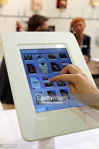Visitor looks at a Apple ebook at the 2014 Frankfurt Book Fair on October 9 2014 in Frankfurt Germany The 2014 fair which is among the world's...