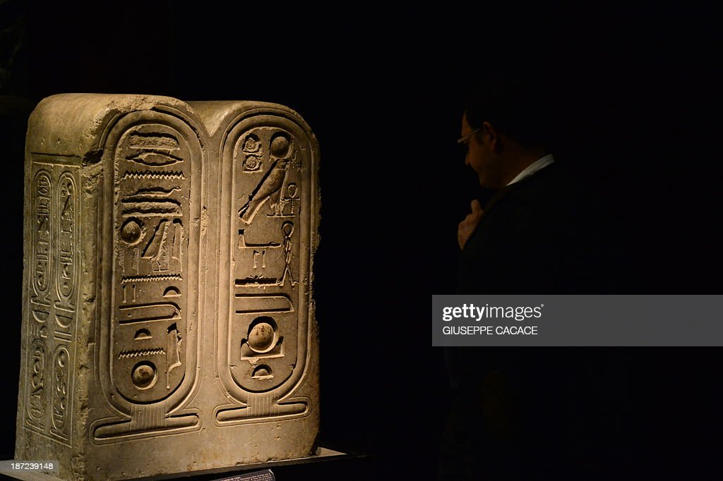 A visitor looks at a 'Block from the Aten Temple' at the Egyptian Museum in Turin on November 7, 2013. The 'Museo delle Antichità Egizie' in Turin is the only museum other than the Cairo Museum that is dedicated solely to ancient Egypt art and culture. AFP PHOTO / GIUSEPPE CACACE