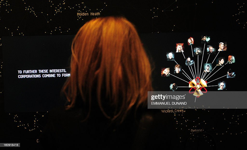 A visitor looks at a demonstration of the video game EVE Online (2003) during an exhibition preview featuring 14 video games acquired by The Museum of Modern Art (MoMA) in New York, March 1, 2013. The MoMA acquired 14 video games entering its collection as part of an ongoing research on interaction design.