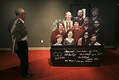 A visitor looks at a display cutout of Microsoft's eleven employees in 1978 featuring a young Bill Gates and Paul Allen on display at the Microsoft...