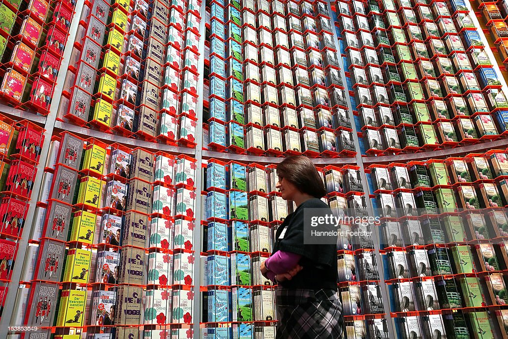 A visitor looks at a display of books at the Droemer stand at the Frankfurt Book Fair on October 10, 2012 in Frankfurt, Germany. The Frankfurt Book Fair is the largest in the world and will run from October 10 - 14, 2012 on October 10, 2012 in Frankfurt am Main, Germany.