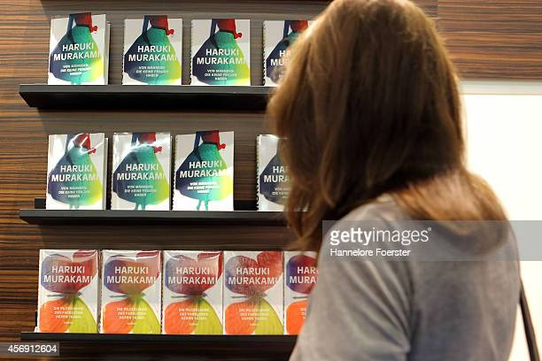 A visitor looks at a display of books of Haruki Murakami at the 2014 Frankfurt Book Fair on October 9 2014 in Frankfurt Germany The 2014 fair which...