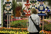 A visitor looks at a flower installation at the socalled flower hall at the opening day of the 'Gruene Woche' agricultural fair in Berlin on January...