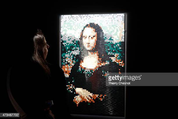 A visitor looks at a Leonard de Vinci painting 'Mona Lisa' made with Lego bricks by US artist Nathan Sawaya during the exhibition 'The Art of The...