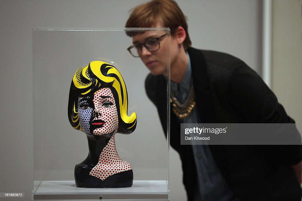 A visitor looks at a Lichtenstein bust during a press preview of 'Lichtenstein, a Retrospective' at the Tate Modern on February 18, 2013 in London, England. The bust is part of a retrospective exhibition by 1960's Pop Artist Roy Lichtenstein, the first of its kind in 20 years, which runs at the gallery until May 27, 2013.