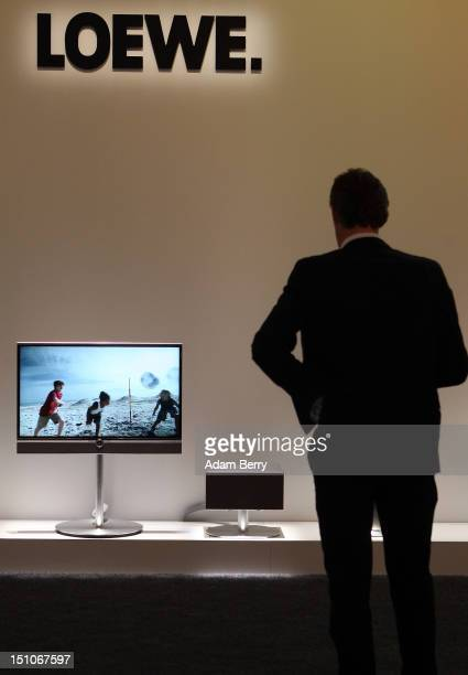 A visitor looks at a Loewe Connect ID television during the Internationale Funkausstellung 2012 consumer electronics trade fair on August 31 2012 in...