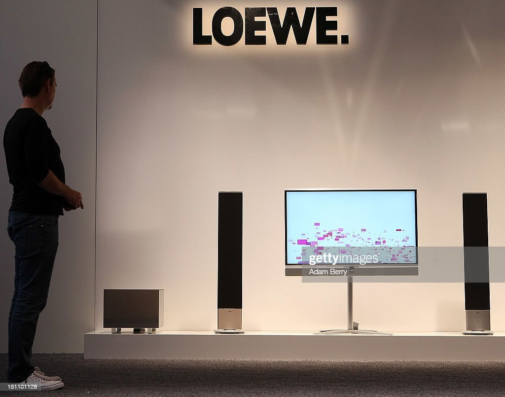 A visitor looks at a Loewe Individual ID television on display at the Internationale Funkausstellung (IFA) 2012 consumer electronics trade fair on September 1, 2012 in Berlin, Germany. IFA 2012 is open to the public from today until September 5.