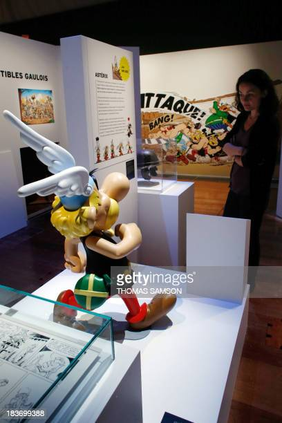 A visitor looks at a model of Asterix' character displayed at the Bibliotheque nationale de France on October 9 in Paris as part of the exhibition...