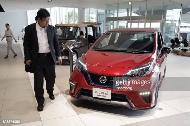 A visitor looks at a Nissan Motor Co Note ePower Nismo vehicle at the company's showroom in Yokohama Japan on Thursday July 27 2017 Nissan is...