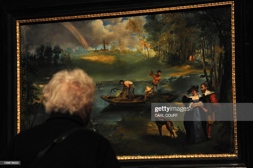 A visitor looks at a painting by French artist Edouard Manet entitled 'Fishing' at the Royal Academy of Arts in central London on January 22, 2013. Forming part of the 'Manet: Portraying Life' exhibition, it is due to be displayed from January 26 to April 14.