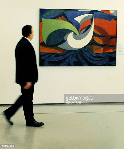 A visitor looks at a painting by Italian painter Giacomo Balla during an exhibition 'Futurismo AvanguardiaAvanguardie' dedicated to Futurism the...
