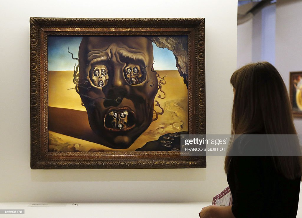 A visitor looks at a painting entitled 'Le visage de la guerre' (The face of war') (1940) by Spanish surrealist artist Salvador Dali during an exhibition devoted to his work at the Centre Pompidou contemporary art center (aka Beaubourg) on November 19, 2012 in Paris. More than 30 years after the first retrospective in 1979, the event gathers more than 200 art pieces and runs until March 13, 2013.