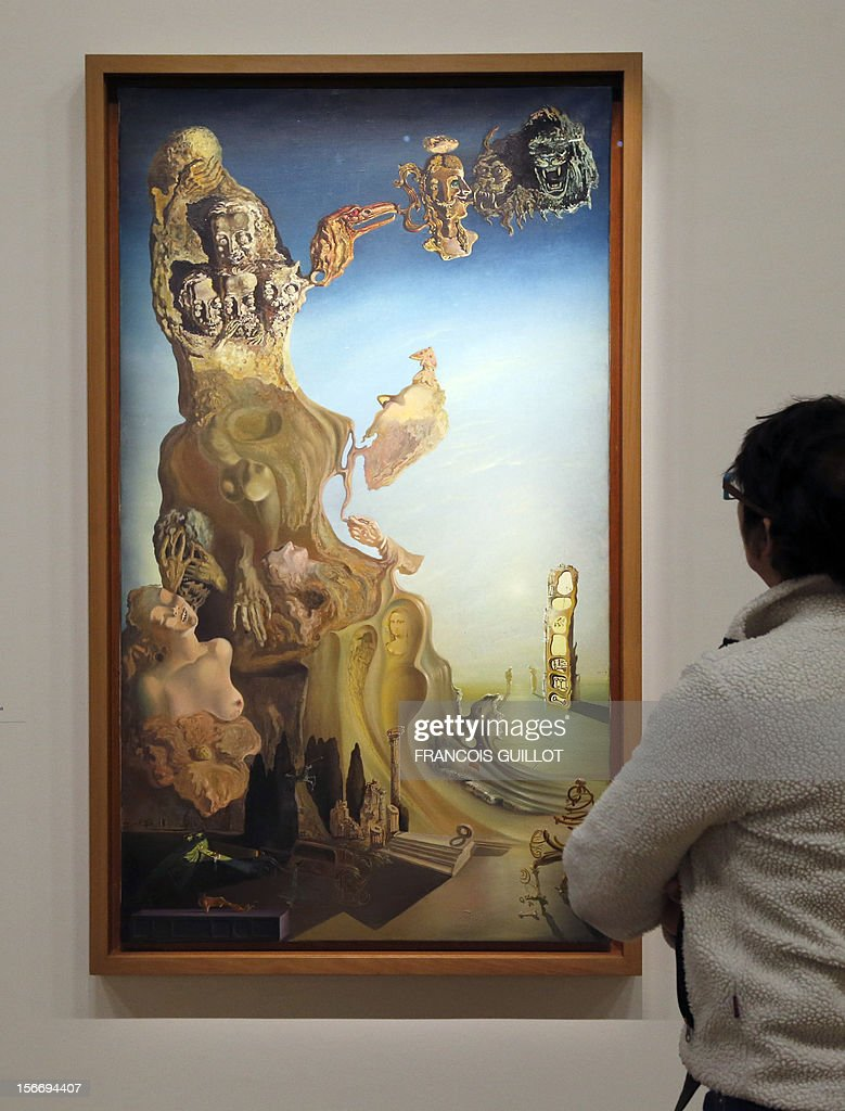 A visitor looks at a painting entitled 'Monument imperial à la femme-enfant' (Imperial Monument to the Child Woman) by Spanish surrealist artist Salvador Dali's during an exhibition devoted to his work at the Centre Pompidou contemporary art center (aka Beaubourg) on November 19, 2012 in Paris. More than 30 years after the first retrospective in 1979, the event gathers more than 200 art pieces and runs until March 13, 2013.