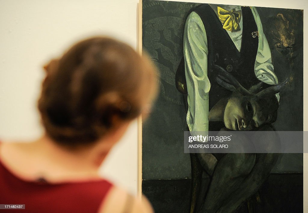 A visitor looks at a painting entitled 'Orlando' by Romanian artist Victor Man on June 25, 2013 during an exhibition at the Villa Medici, the headquarters of the French Academy in Rome.