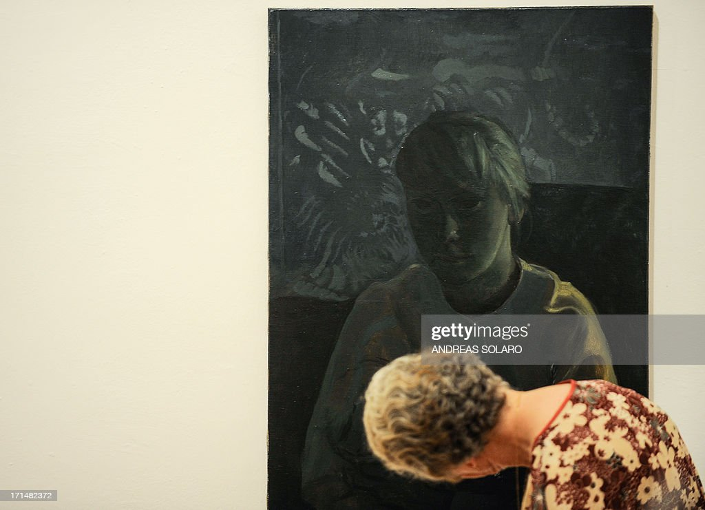 A visitor looks at a painting entitled 'S.D. as Judith and Holofernes' by Romanian artist Victor Man on June 25, 2013 during an exhibition at the Villa Medici, the headquarters of the French Academy in Rome.