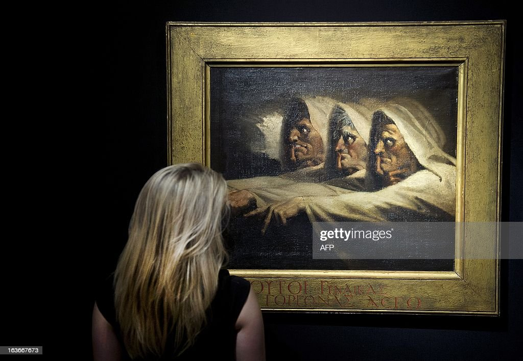A visitor looks at a painting entitled 'The Three Witches' by Swiss artist Henry Fuseli (Johann Heinrich Füssli) displayed at the Art and Antiques Fair TEFAF in Maastricht, Netherlands, on March 14, 2013. The event runs from 15 to March 24, 2013. AFP PHOTO / ANP / MARCEL VAN HOORN netherlands out RESTRICTED TO EDITORIAL USE - MANDATORY CREDIT 'AFP PHOTO / HO / SANA' - NO