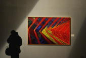 A visitor looks at a painting on show at the opening of a new exhibition on futurism at the Scuderie del Quirinale in Rome on February 19 2009...