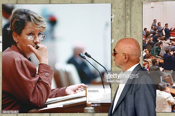 A visitor looks at a photo of Sabine BergmannPohl president of the Volkskammer of East Germany from April to October 1990 at an event to celebrate...