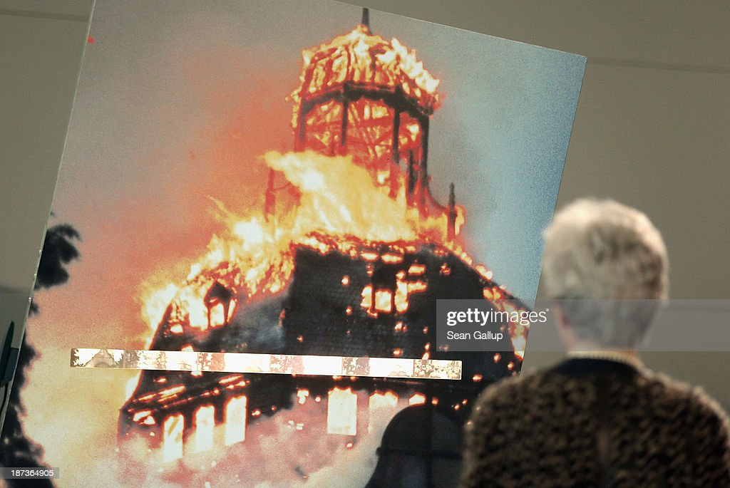 A visitor looks at a photograph of a synagogue burning during the 1938 Kristallnacht pogroms at an exhibit at the Topography of Terror museum on November 8, 2013 in Berlin, Germany. Events are taking place across Germany this weekend to commemorate the 75th anniversary of Kristallnacht, when on November 10, 1938 Nazi gangs across Germany and Austria burned down over 1,000 synagogues, smashed Jewish-owned businesses, looted Jewish residences and killed several hundred Jews. Anti-Semitism was a central component of Adolf Hitler's rise to power and won him wide-spread sympathy among ordinary Germans and Austrians.