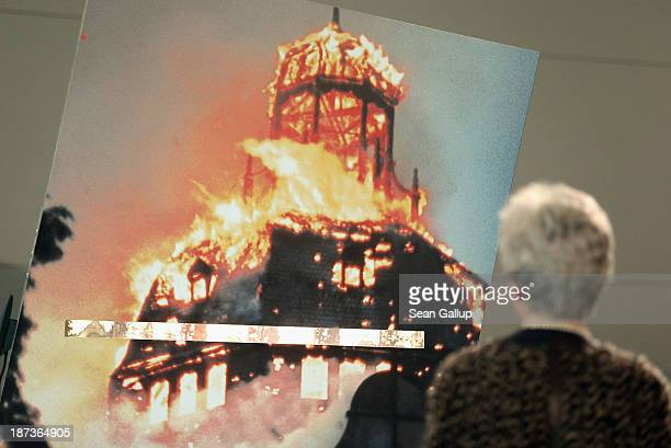 A visitor looks at a photograph of a synagogue burning during the 1938 Kristallnacht pogroms at an exhibit at the Topography of Terror museum on...