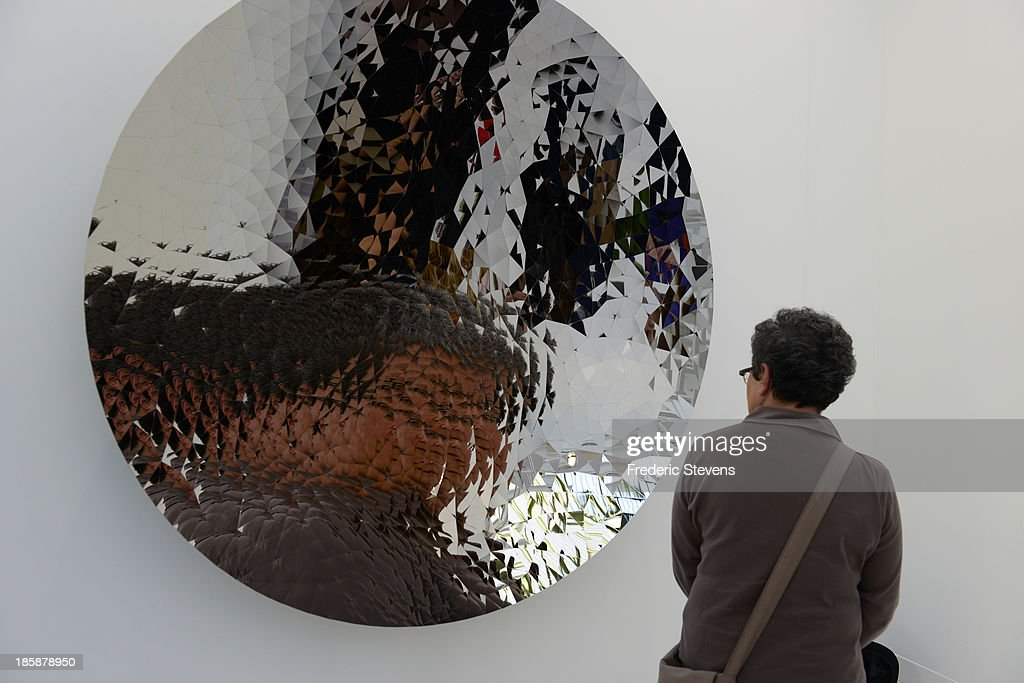 A visitor looks at a piece by British artist Anish Kapoor at the Grand Palais as part of the exhibition of the FIAC International Contemporary Art Fair on October 25, 2013 in Paris, France. This is the 40th anniversary edition of