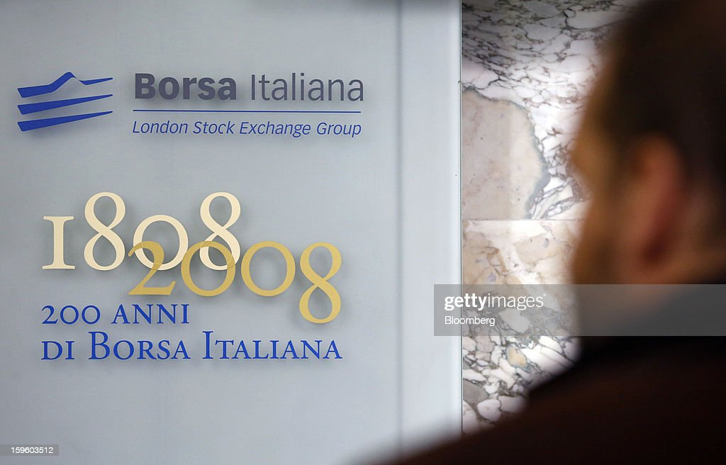 A visitor looks at a plaque commemorating the 200th anniversary of the Borsa Italiana, inside Italy's stock exchange, which is part of the London Stock Exchange Group Plc, in Milan, Italy, on Thursday, Jan. 17, 2013. The euro-area economy won't return to growth until the next quarter as a recovery in Italy is delayed and France continues to shrink, according to a survey of economists. Photographer: Alessia Pierdomenico/Bloomberg via Getty Images