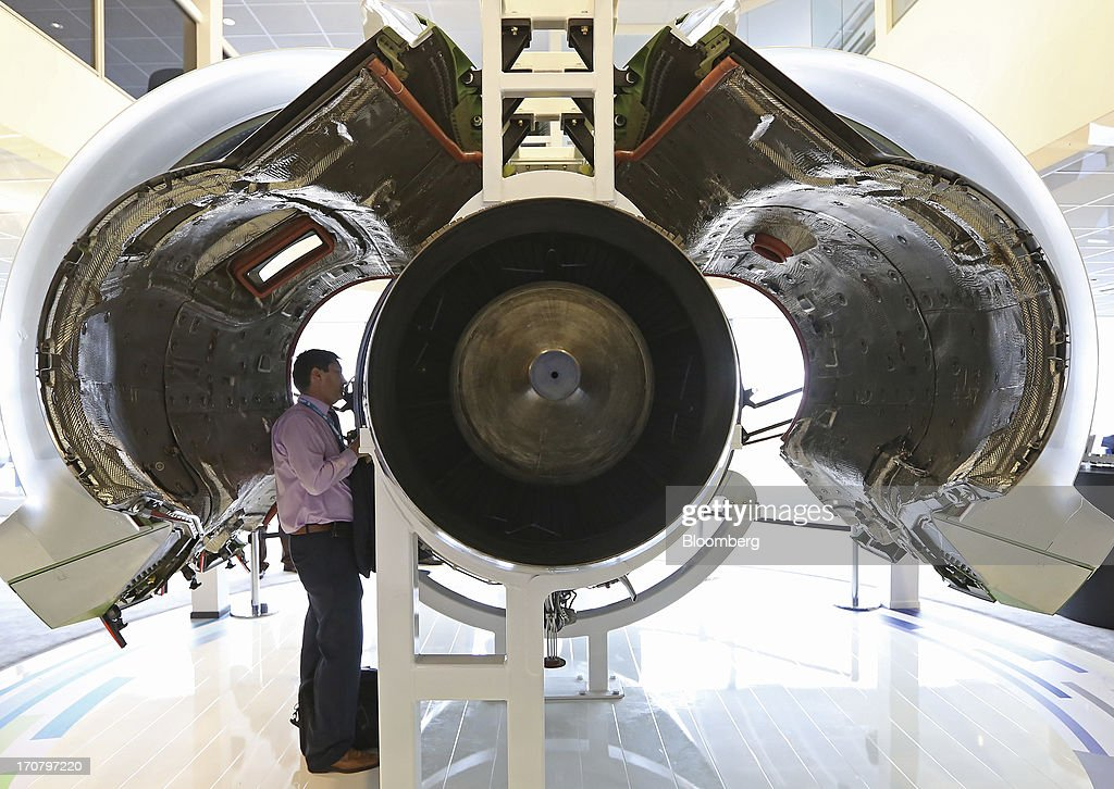 A visitor looks at a PurePower PW1500 aircraft engine manufactured by Pratt & Whitney, a unit of United Technologies Corp., on the second day of the Paris Air Show in Paris, France, on Tuesday, June 18, 2013. The 50th International Paris Air Show is the world's largest aviation and space industry show, and takes place at Le Bourget airport June 17-23. Photographer: Chris Ratcliffe/Bloomberg via Getty Images