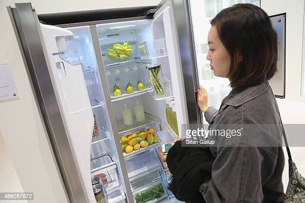 A visitor looks at a RH900HC refrigerator at the Samsung stand during a press day at the 2015 IFA consumer electronics and appliances trade fair on...