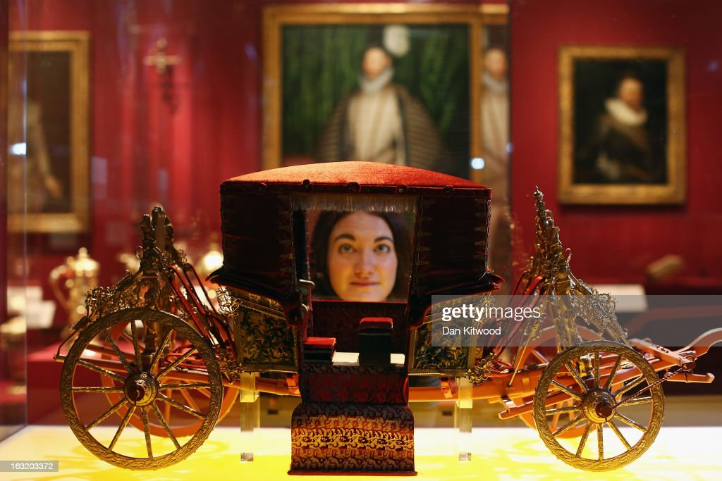 A visitor looks at a scale model of a carriage during a press preview of the V&A's new exhibit on March 6, 2013 in London, England. The exhibition, 'Treasures of the Royal Court: Tudors, Stuarts and the Russian Tsars' examines the development of cultural diplomacy and trade between Britain and Russia from it's origins in 1555. The runs at the V&A museum until July 14, 2013.