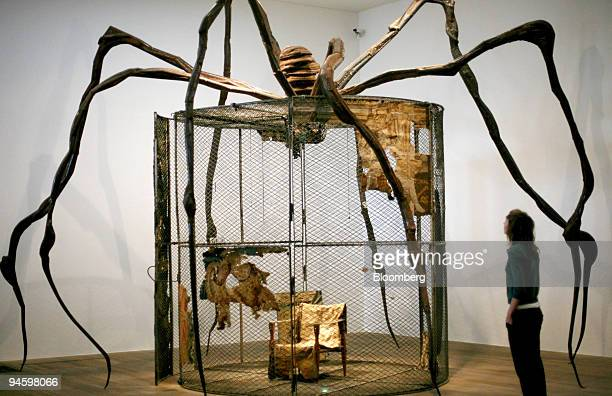 A visitor looks at a sculpture by artist Louise Bourgeois at Tate Modern in London UK on Monday Oct 8 2007 Bourgeois' art deals with everything that...
