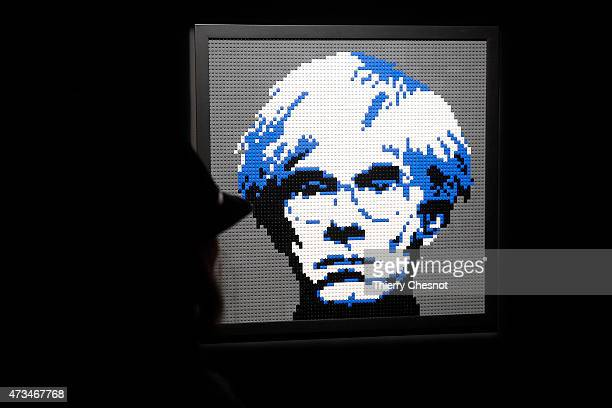 A visitor looks at a sculpture showing a portait of Andy Warhol made with Lego bricks by US artist Nathan Sawaya during the exhibition 'The Art of...