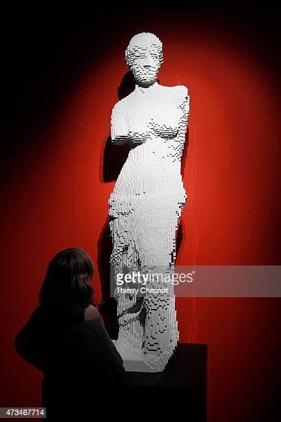 A visitor looks at a sculpture showing 'Venus de Milo' made with Lego bricks by US artist Nathan Sawaya during the exhibition 'The Art of The Brick'...