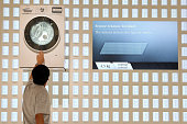 A visitor looks at a Siemens energy efficient iDos clothes dryer at the Internationale Funkausstellung 2012 consumer electronics trade fair on August...