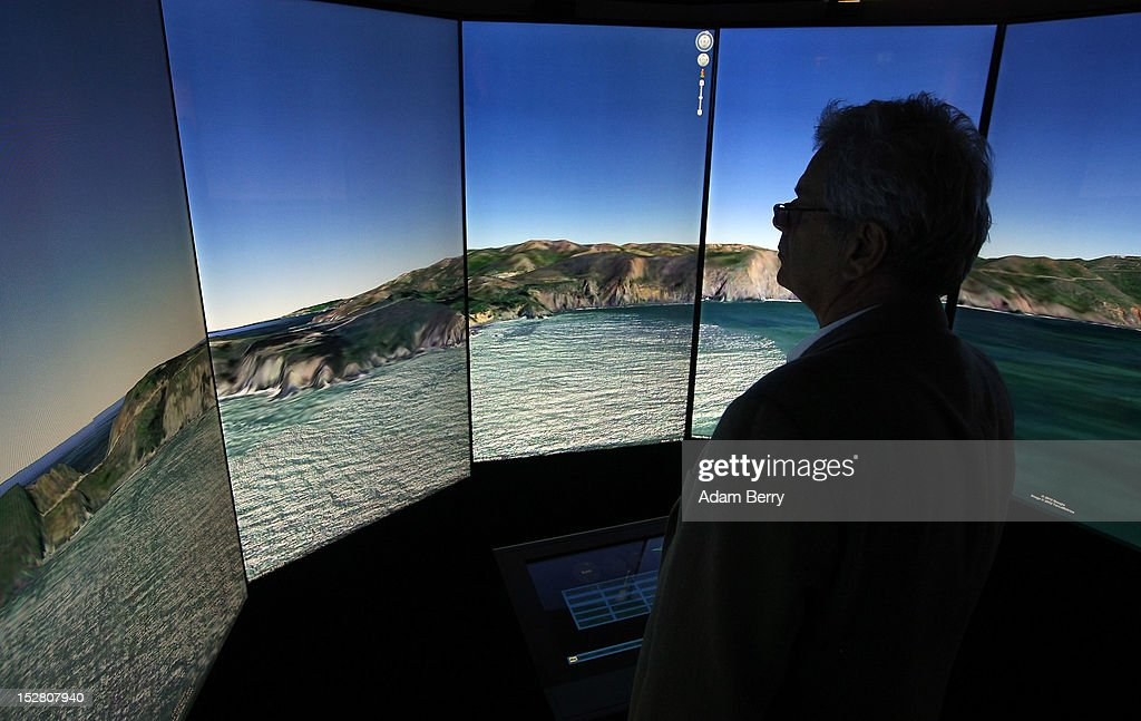 A visitor looks at a three-dimensional rendering of a coastline while using Google Earth software on September 26, 2012 at the official opening party of the Google offices in Berlin, Germany. Although the American company holds 95% of the German search engine market share and already has offices in Hamburg and Munich, its new offices on the prestigious Unter den Linden avenue are its first in the German capital. The Internet giant has been met with opposition in the country recently by the former president's wife, who has sued it based on search results for her name that she considers derogative. The European Commission has planned new data privacy regulations in a country where many residents opted in to have their homes pixeled out when the company introduced its Street View technology.