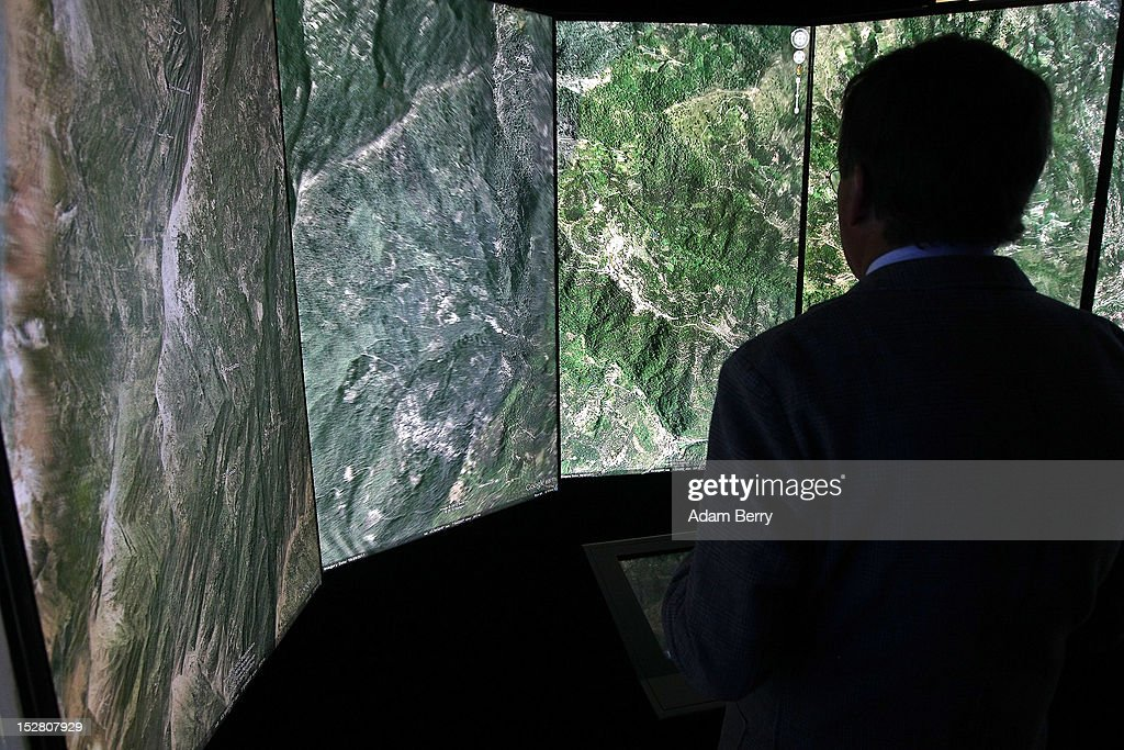 A visitor looks at a three-dimensional rendering of French mountains using Google Earth software on September 26, 2012 at the official opening party of the Google offices in Berlin, Germany. Although the American company holds 95% of the German search engine market share and already has offices in Hamburg and Munich, its new offices on the prestigious Unter den Linden avenue are its first in the German capital. The Internet giant has been met with opposition in the country recently by the former president's wife, who has sued it based on search results for her name that she considers derogative. The European Commission has planned new data privacy regulations in a country where many residents opted in to have their homes pixeled out when the company introduced its Street View technology.