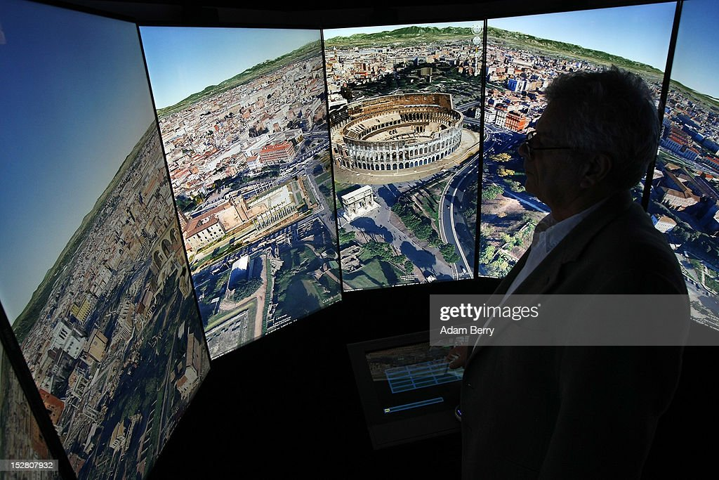 A visitor looks at a three-dimensional rendering of Rome while using Google Earth software on September 26, 2012 at the official opening party of the Google offices in Berlin, Germany. Although the American company holds 95% of the German search engine market share and already has offices in Hamburg and Munich, its new offices on the prestigious Unter den Linden avenue are its first in the German capital. The Internet giant has been met with opposition in the country recently by the former president's wife, who has sued it based on search results for her name that she considers derogative. The European Commission has planned new data privacy regulations in a country where many residents opted in to have their homes pixeled out when the company introduced its Street View technology.