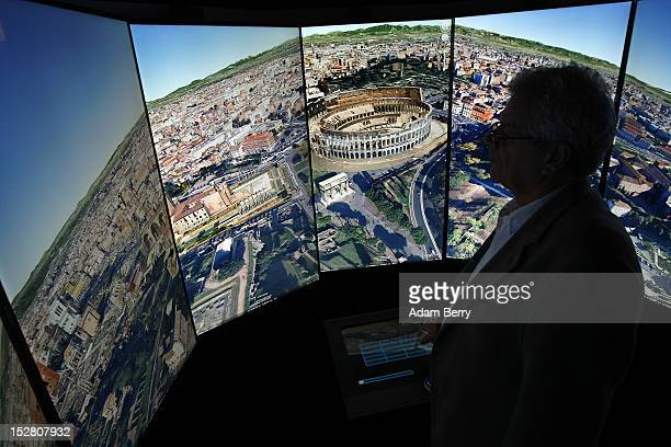 A visitor looks at a threedimensional rendering of Rome while using Google Earth software on September 26 2012 at the official opening party of the...