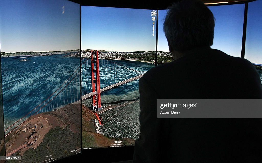 A visitor looks at a three-dimensional rendering of San Francisco while using Google Earth software on September 26, 2012 at the official opening party of the Google offices in Berlin, Germany. Although the American company holds 95% of the German search engine market share and already has offices in Hamburg and Munich, its new offices on the prestigious Unter den Linden avenue are its first in the German capital. The Internet giant has been met with opposition in the country recently by the former president's wife, who has sued it based on search results for her name that she considers derogative. The European Commission has planned new data privacy regulations in a country where many residents opted in to have their homes pixeled out when the company introduced its Street View technology.