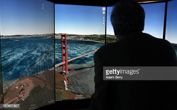 A visitor looks at a threedimensional rendering of San Francisco while using Google Earth software on September 26 2012 at the official opening party...